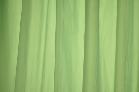 drapery: light green vertical drapery fabric curtains  folds