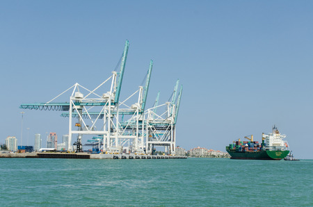 Cargo ship and containers at port area