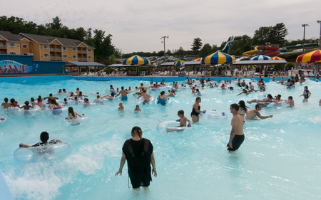 People having good time in a wave pool at a water park