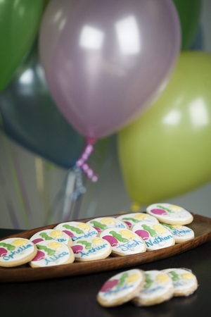 Sugar Cookies Decorated with Name and Balloons for Birthday Party Stock Photo