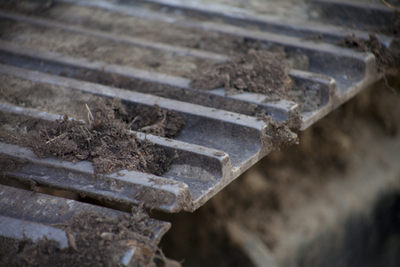 Macro of Dirty Tread of a Digger or Bulldozer