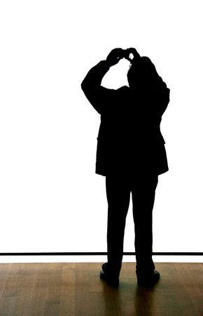 Silhouette of a man taking a picture with a P/S camera over white blank nothing, anything can be put in front or above him. Stock Photo - 1297637