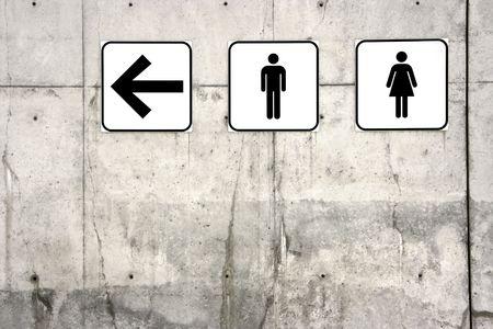 Männliche und weibliche WC Zeichen (Pfeil nach links)