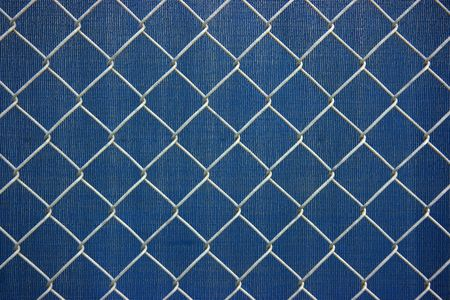 chainlink: Metal chainlink grid fence over plastic blue