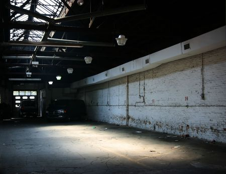 almost: Almost empty industrial warehouse parking, a bit grungy Stock Photo