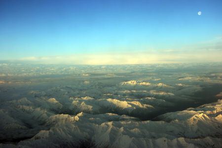 midwest usa: Flying over white mountains at sunset, Midwest USA