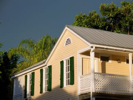 florida house: Wooden beige house and storm at sunset Stock Photo