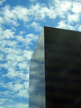reminding: Black glass skyscraper reminding monolith from 2001: A Space Odissey