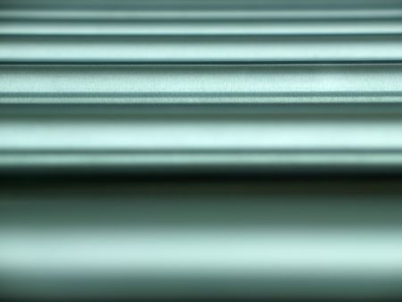 Abstract background with brushed horizontal metal pipes, focus is on the third from bottom Stock Photo - 1335151