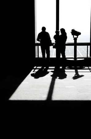looking forward: Silhouette of a  in front of an observatory window, looking outside