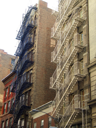 Black and white metal fire escape ladders, Manhattan, New York Stock Photo - 1365954
