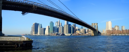 Panoramic view of Brooklyn bridge, lower Manhattan and financial district, New York