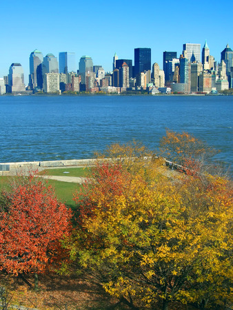 Lower Manhattan seen from Liberty Island in autumn, New York Stock Photo