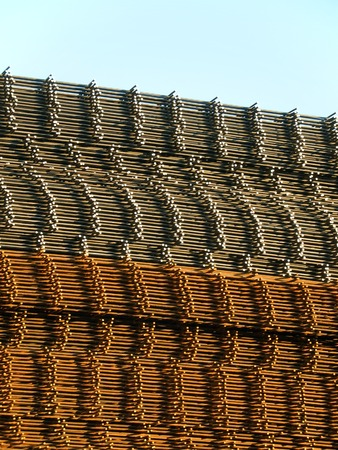 Stacked reinforcing rods, new over rusty ones Stock Photo - 1385394