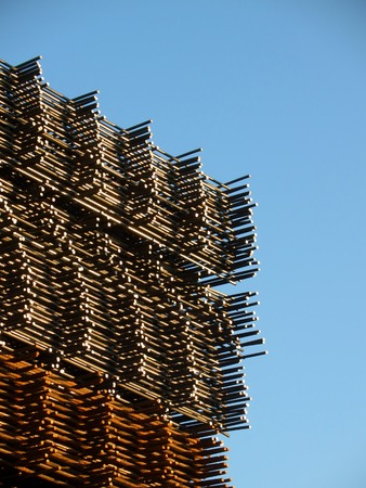 Stacked reinforcing rods, new over rusty ones, angled view with sky Stock Photo - 1385380