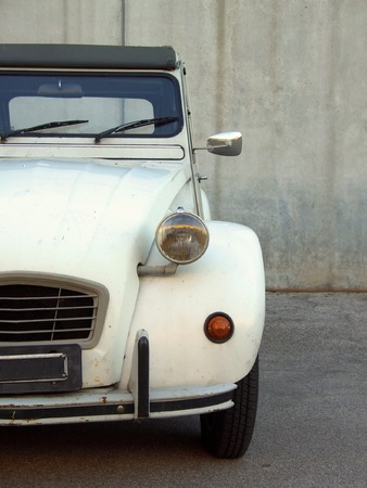 A beige Citroen 2cv from the 80s, partial frontal view photo