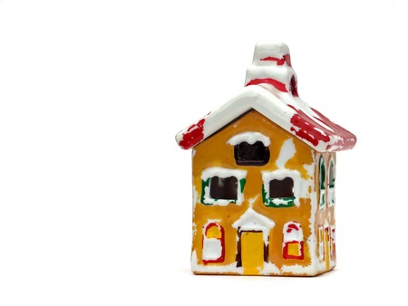 scraped: Little ceramic house isolated on white background, scraped paint Stock Photo
