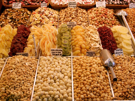 Mixed candied fruits and nuts on display in market, Barcelona, Spain