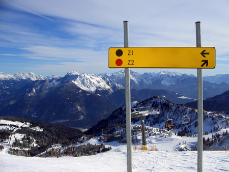 piste: Red and black piste sign on mountaintop, Friuli, Italy