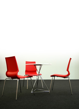 Design chairs and table in a business environment, light from top photo