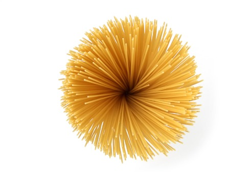Uncooked spaghetti pasta reminding a sunflower, isolated on white background photo