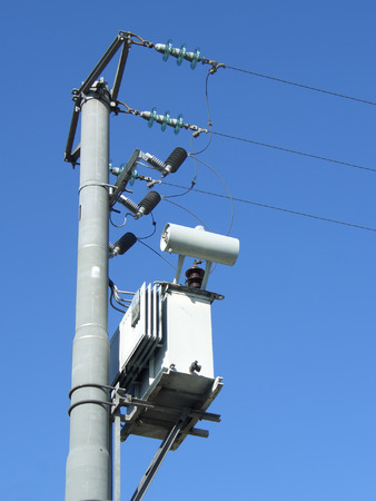 Powerline pole and transformer seen from below against blue sky Stock Photo - 1374136