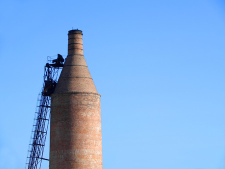 brick kiln: Old drying kiln brick smokestack with metal ladder Stock Photo