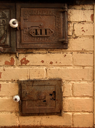 firebox: Antique brick oven detail. Paint is falling off, doors are rusted and broken.