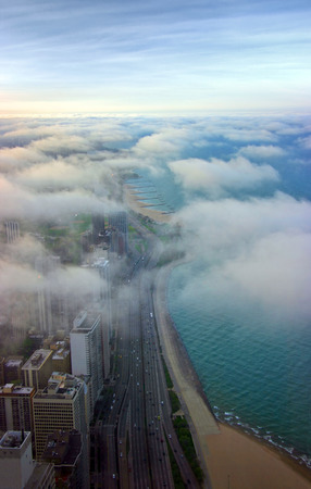 Michigan lake shore covered by clouds aerial view at sunset