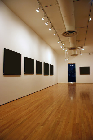 Contemporary museum gallery interior, blank paintings and photographs Stock Photo