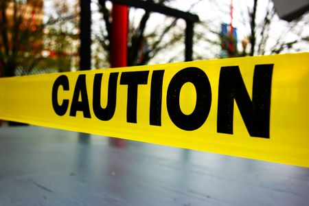 Caution text on yellow warning tape  스톡 콘텐츠