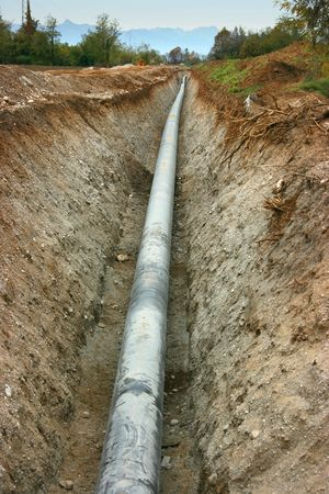 underground: Work in progress burying gas pipe in a country area Stock Photo