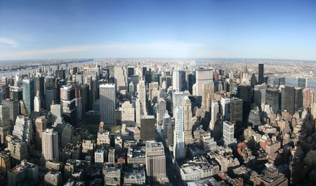 Aerial panoramic view over Manhattan from Empire State building top, New York. Sunny day, exceptional visibility, you could see far far away.