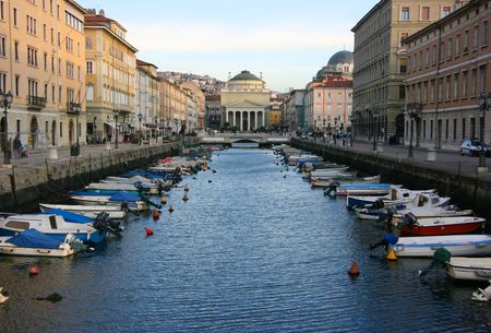 Canal grande in Trieste with Saint Anthony church 스톡 콘텐츠