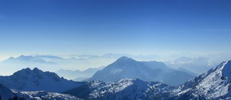 High angle panoramic view of the winter Giulian alps in the fog, as seen from passo Pramollo on the border between Italy and Austria photo