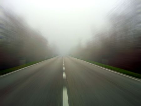 Speeding the middle of a road in the fog. Radial blur photo