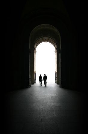existence: Two people exiting from a baroque building though a gate towards the light