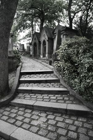 rising dead: Path and tombs in Pere Lachaise cemetery in Paris