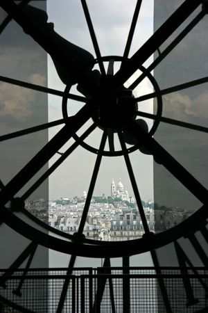 coeur: Sacre Coeur basilique in Montmartre seen though the clock on top of Orsay Museum in Paris