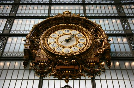 Art nouveau clock on the glass wall from the former railway station in Orsay museum in Paris photo