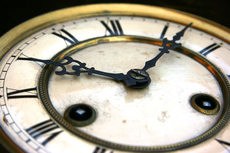 winder: Antique clock face detail with roman numerals Stock Photo