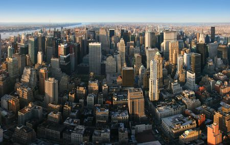 Aerial panoramic view over Manhattan from Empire State building top, New York. Sunset of a clear, sunny day. Stock Photo