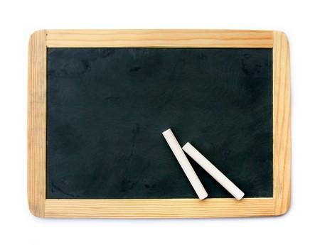 white chalks: Peque�a escuela de madera en blanco pizarra en blanco y tizas aisladas sobre fondo blanco