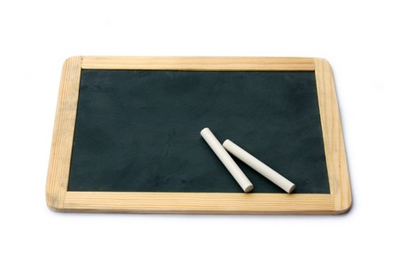 antique sleigh: Perspective view of a small school wooden blank blackboard and white chalks isolated on white background Stock Photo