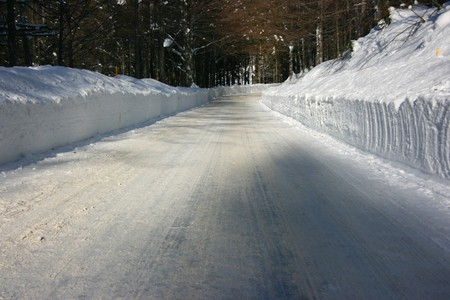 Road in the forest covered by snow Stock Photo - 4102748