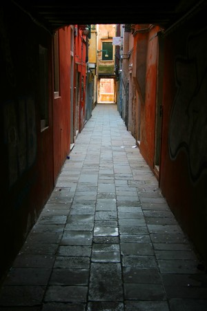 backstreet: Small backstreet in Venice enclosed by colored buildings Stock Photo