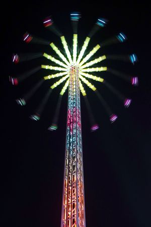 chairoplane: High swing carousel at night seen from below