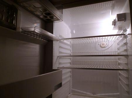 fridge lamp: Interior of an empty fridge lit by the internal lamp Stock Photo
