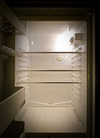 Interior of an empty fridge lit by the internal lamp Stock Photo