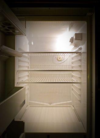 freezer: Interior of an empty fridge lit by the internal lamp Stock Photo